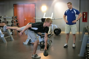 Scott Mayfield knocking out a single leg kettle bell deadlift with Coach Dave Reddy