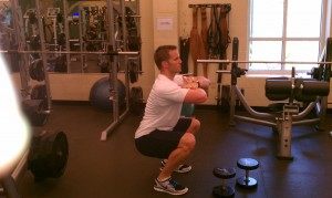 Dave Reddy doing a genie squat to demo flat back and upright posture