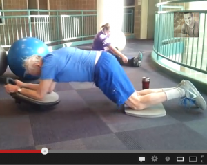 Dave Reddy and Paul Cahn performing a ab dolly roll out