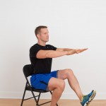 Dave Reddy performing a single leg squat off of a chair